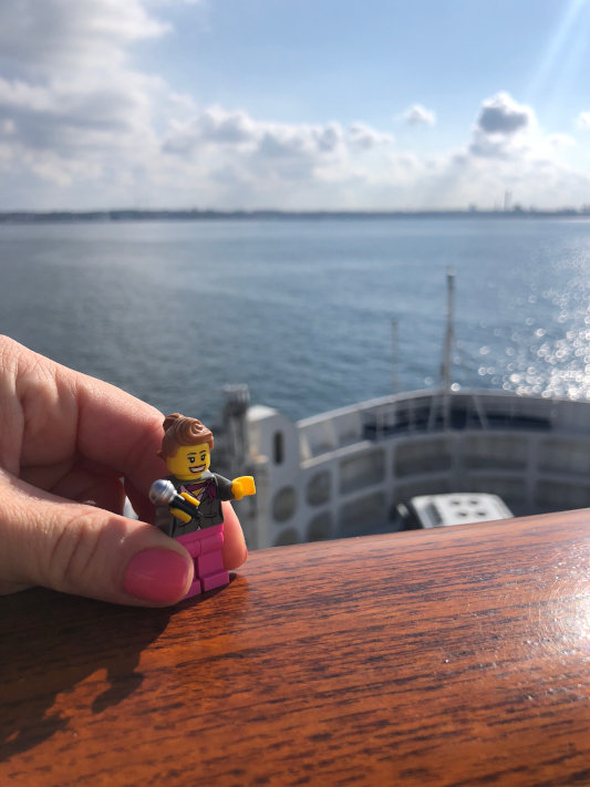 A photo of a lego piece resembling Sheridan. Ocean in background