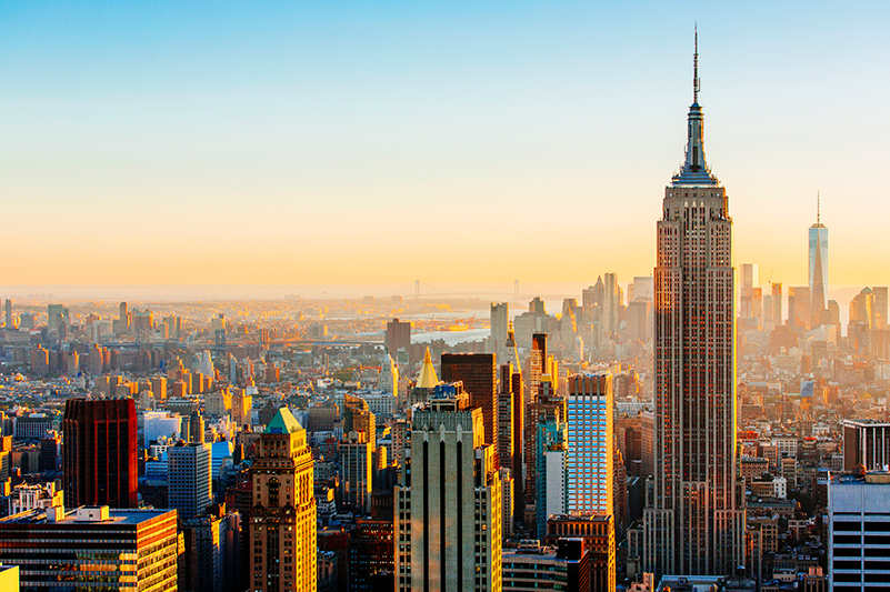New york skyline at sunset with empire state building as centre