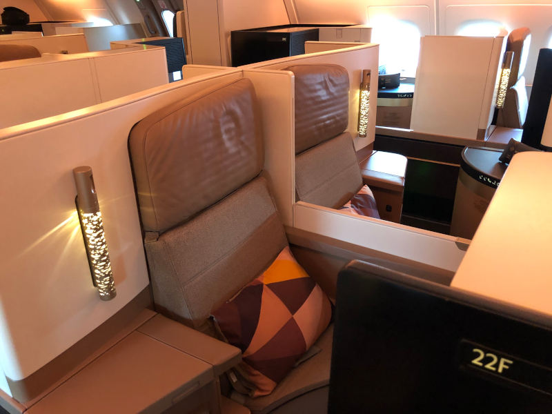 Two business class seats close together