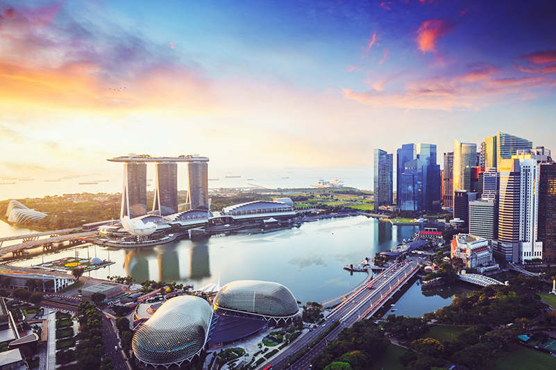 a view of the singapore skyline with marina bay sands in the distance