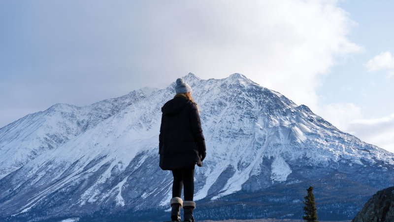 Isabella contemplates the majesty of Alsek Valley, the mountain tall in the background