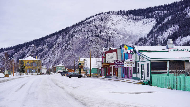The colourful facades of shopfronts in historic Dawson City