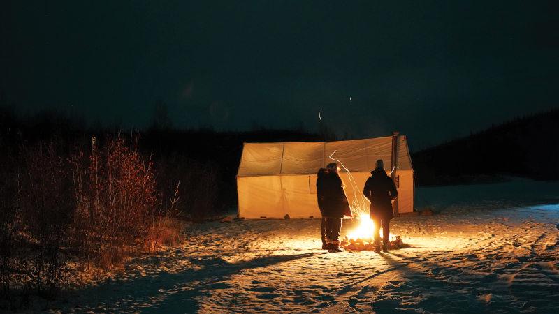 Warming up around the fire in Dawson City