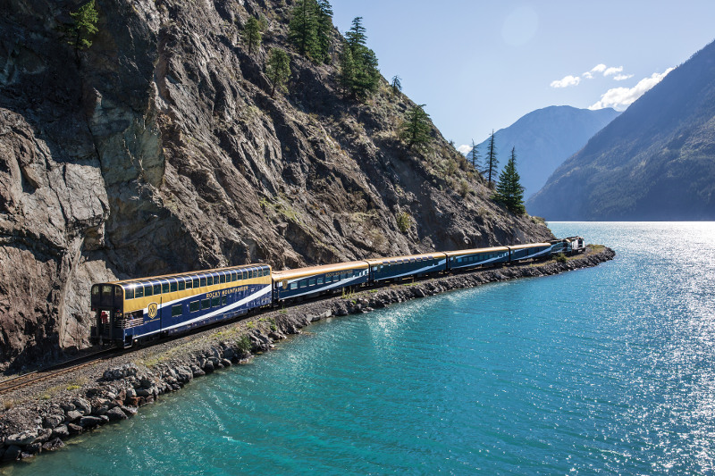 The Rocky Mountaineer running along the water's edge