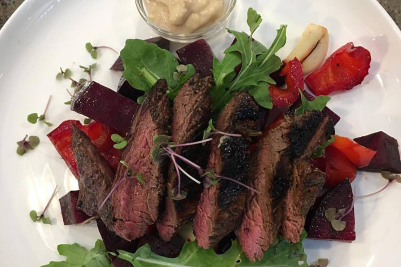 A plate of steak and salad