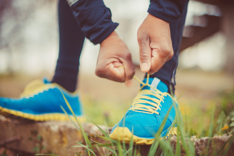 A person putting their running shoes on
