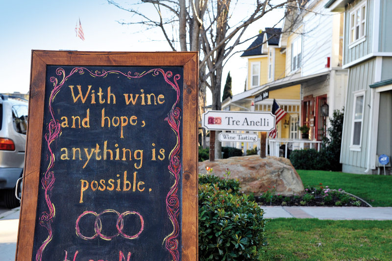 A sign outside a wine-tasting place in Santa Barbara reads: With wine and hope, anything is possible.