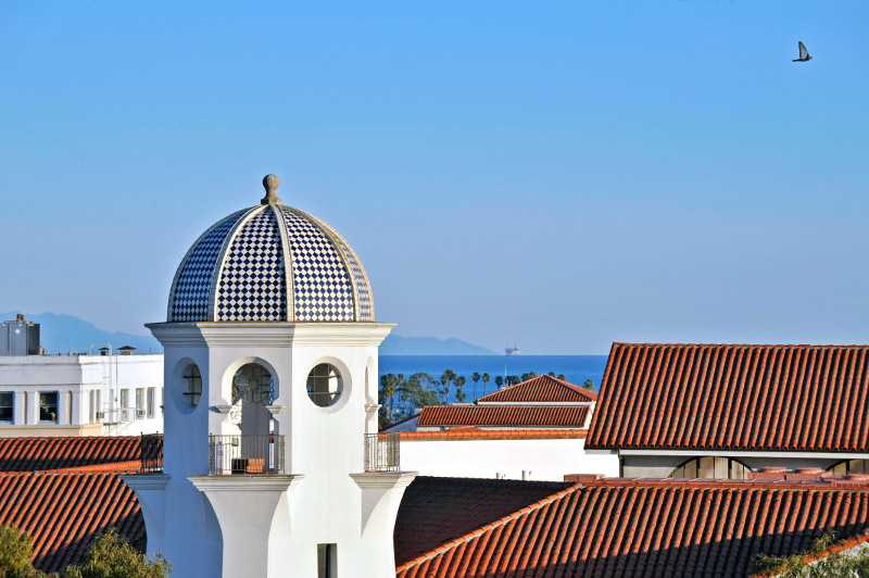 A view over red-tiled roofs to the sea in Santa Barbara.