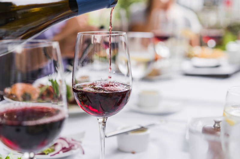 A glass of red wine is poured in a restaurant in Santa Barbara, California.