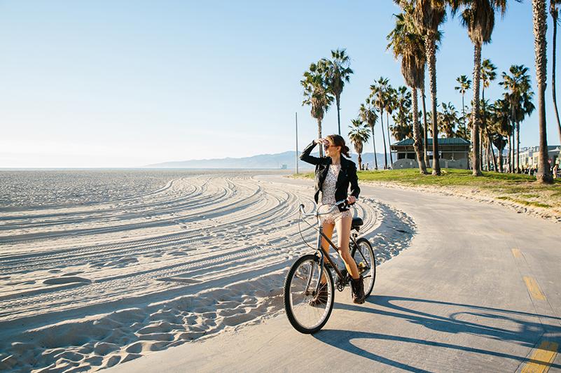 Woman cycling on Santa Monica trail