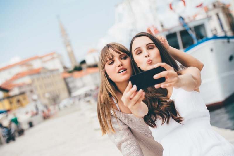 Friends taking a selfie in Europe.