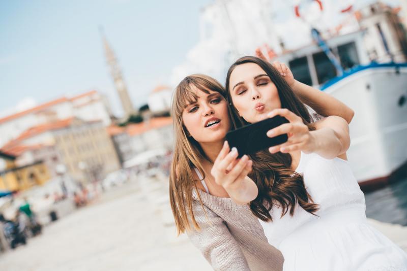 Friends taking a selfie in Europe.