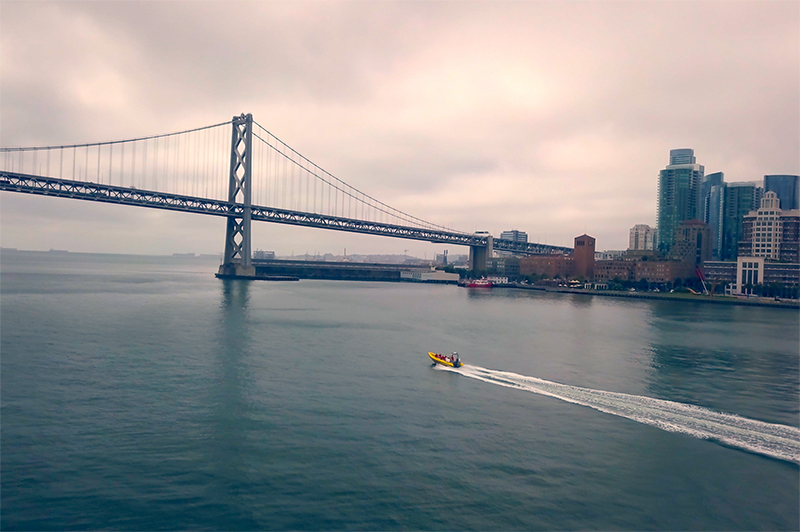 A boat zips along the San Francisco harbour near the Golden Gate Bridge.