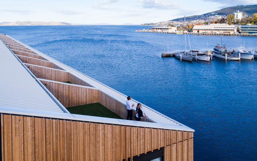 Image of couple on rooftop of MACq 01 looking out over the harbour in Hobart