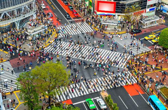 Crowd of people crossing the Shibuya Crossing in Tokyo
