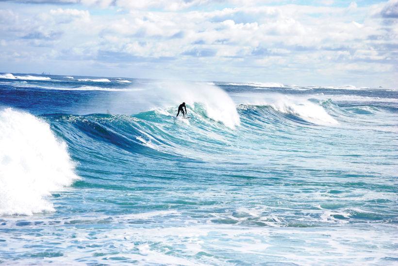surfer on wave margaret river western australia