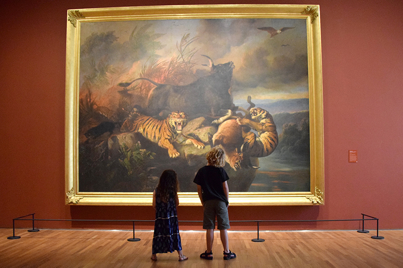 Two children looking at a painting at National Gallery Singapore