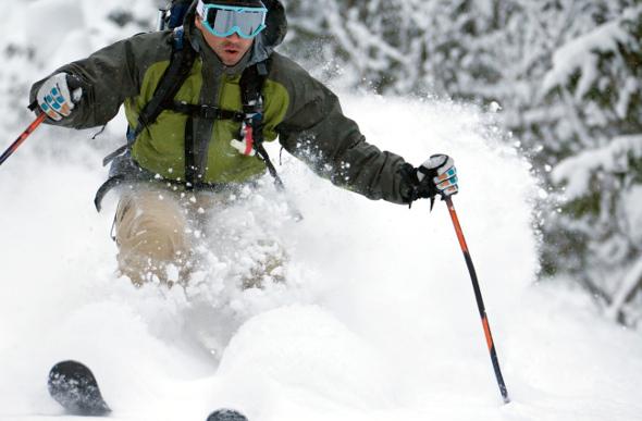 A skier swishing through the snow