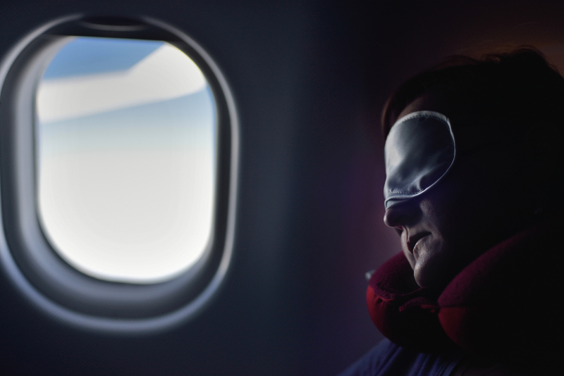 A person sleeping on a plane