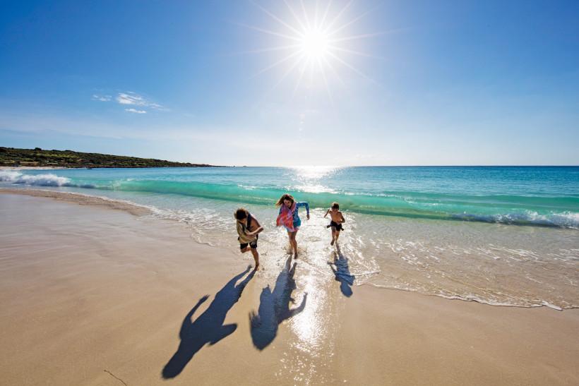 family running on beach in margaret river western australia