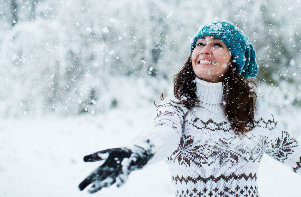 A young woman watching the snow fall