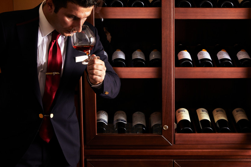 sommelier smelling wine