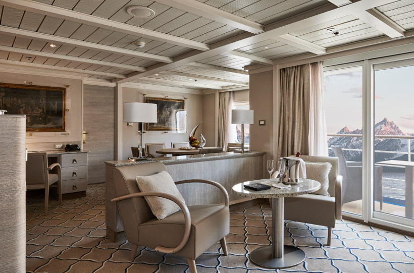 suite onboard silver cloud with snow-capped mountains behind