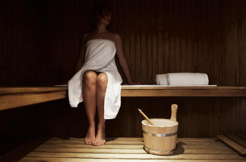 woman in towel in sauna