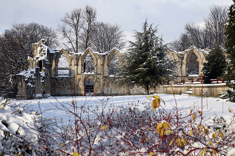 St Mary's Abbey in York covered in snow in wintertime.