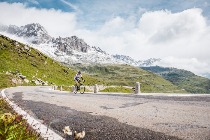 Follow in the path of cycling legend Bruno Risi, pictured here shortly before the Furka summit. Image: Switzerland Tourism.