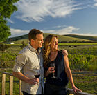 Couple poses with wine in SA Vineyard