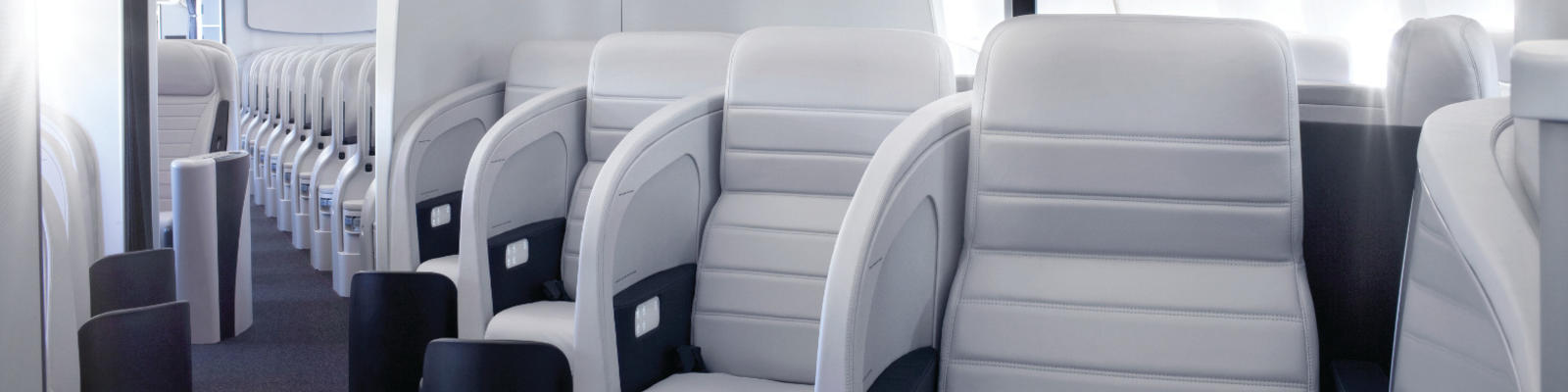 A view up the aisle of the Business Class cabin of an Air New Zealand plane