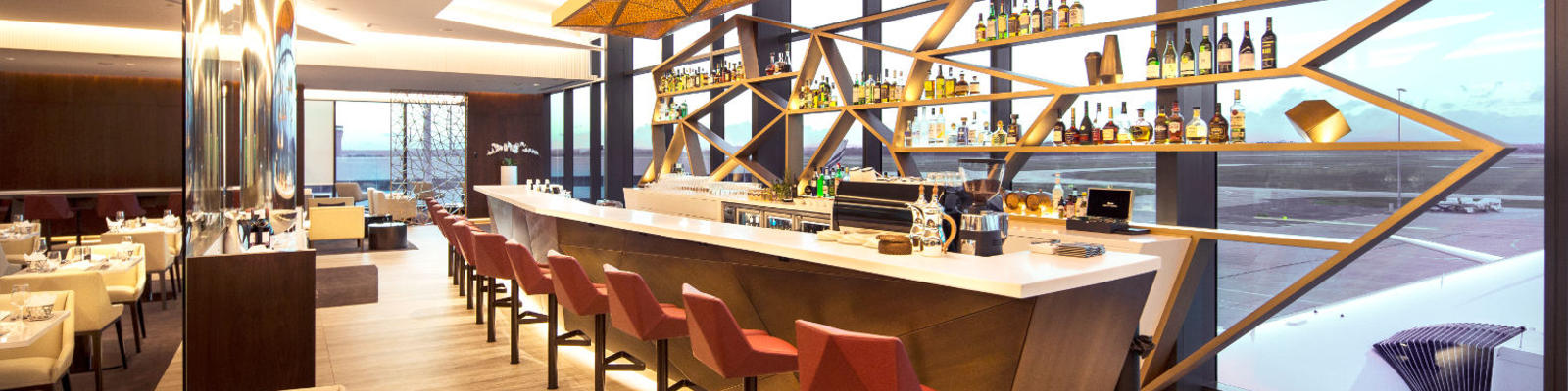 A view of the new Etihad lounge bar in Melbourne Airport, overlooking the runway beyond