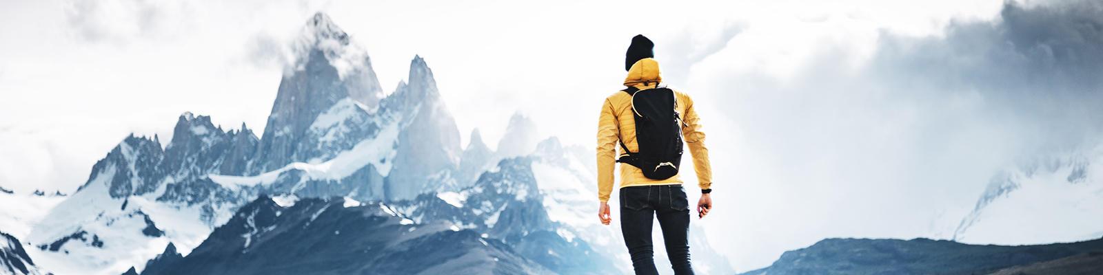 A hiker looks at the looming El Chatan Peak in Patagonia