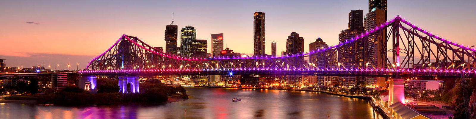 Brisbane's skyline, featuring the Story Bridge, at twilight.