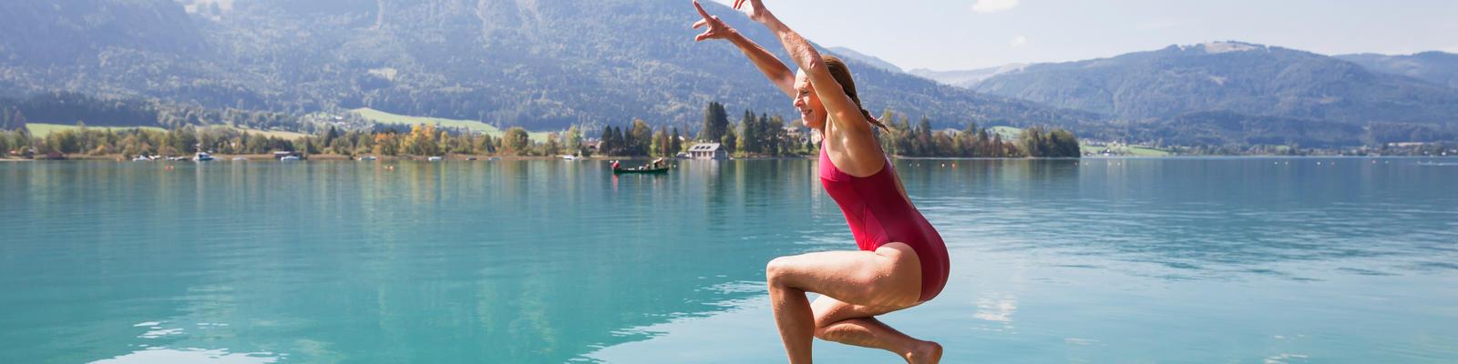 dear travel woman jumping into lake
