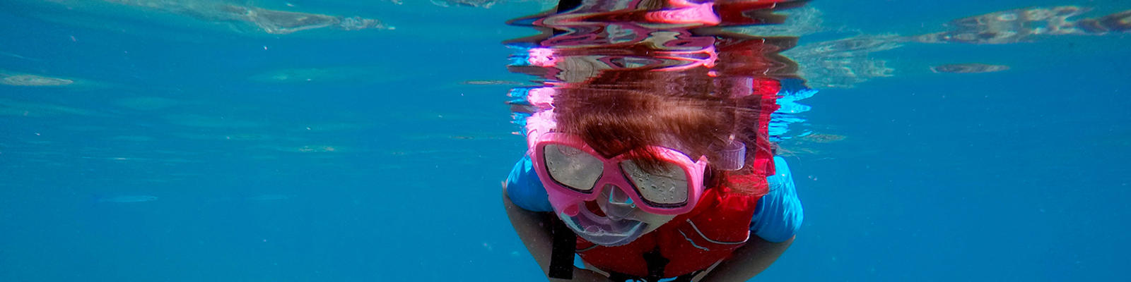 Child snorkelling in Fiji
