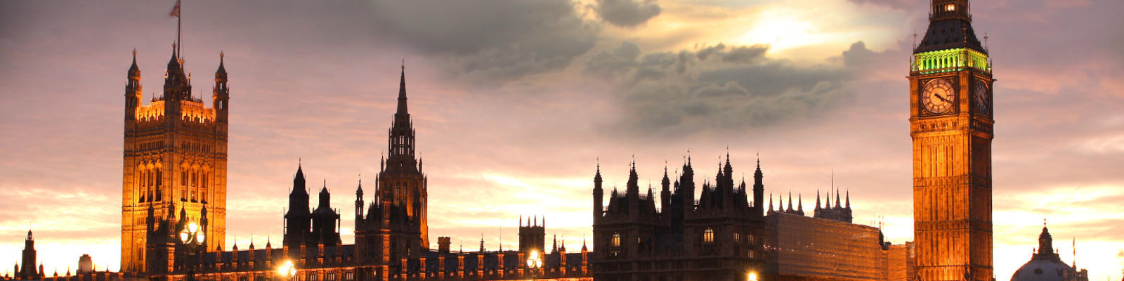 A panoramic shot of London's Houses of Parliament and Big Ben at sunset