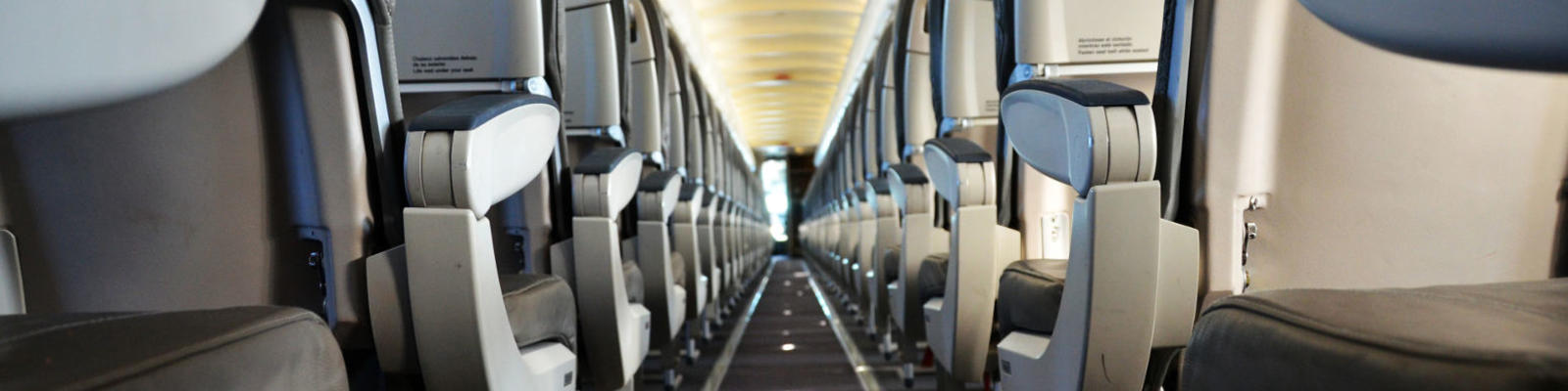 looking down centre aisle of aircraft