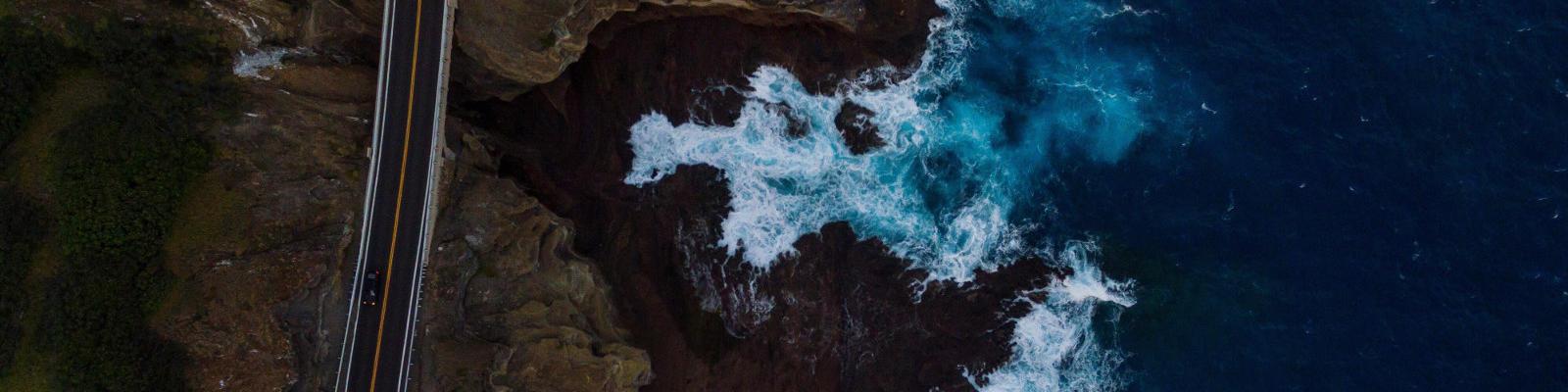 road along volcanic coastline hawaii