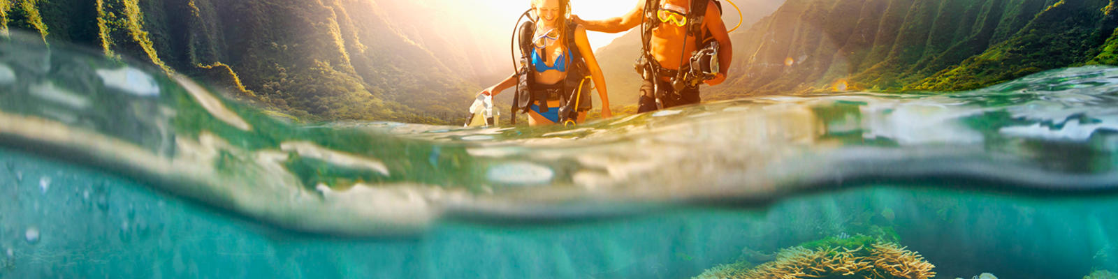 A couple scuba diving in Hawaii