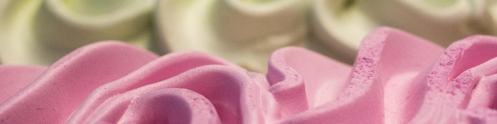 A close up of vanilla and strawberry ice cream