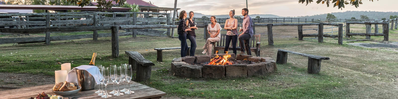 group around fire pit spicers hidden vale