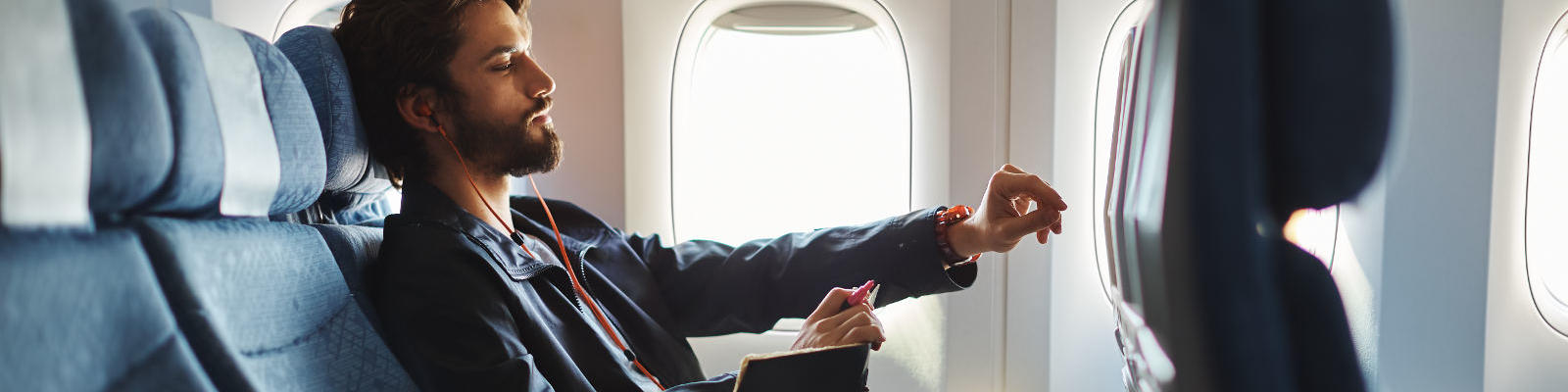 man in economy cathay pacific