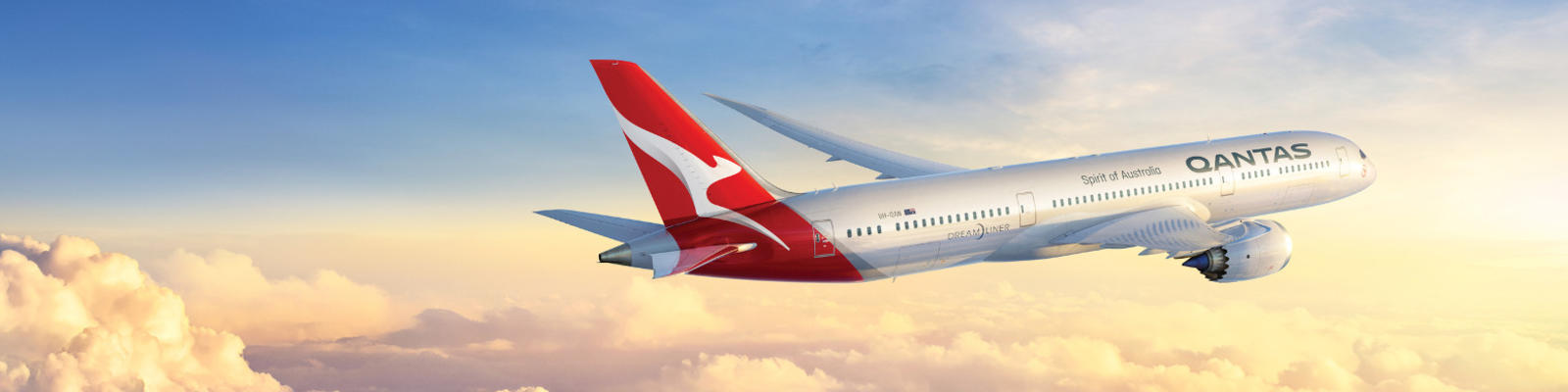 The Qantas Dreamliner flies through the clouds.
