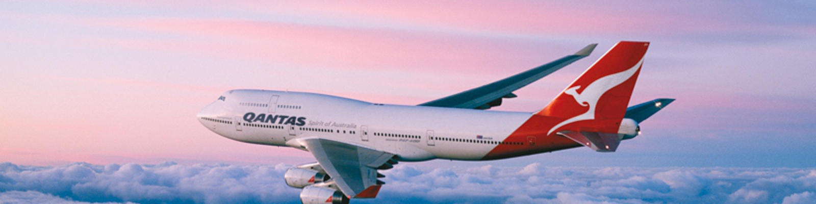 Qantas airplane flying over the purple and blue horizon