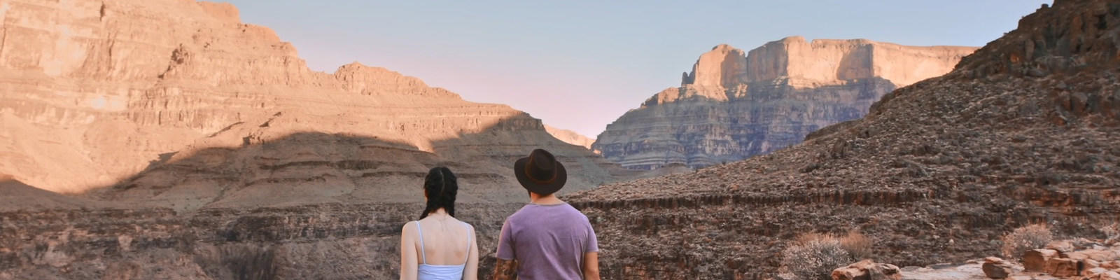 Two travellers at Grand Canyon looking out into the distance