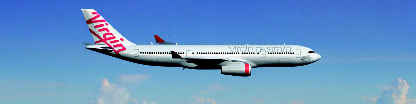 Virgin Australia airplane flying through blue skies with fluffy clouds in the background