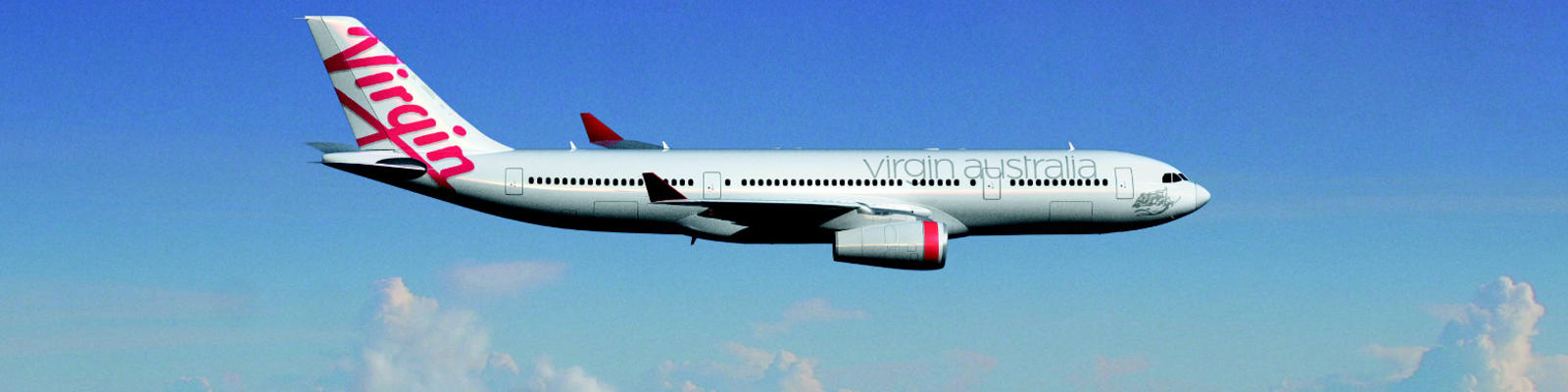 A Virgin Australia airplane flying through the blue sky with fluffy clouds in the background