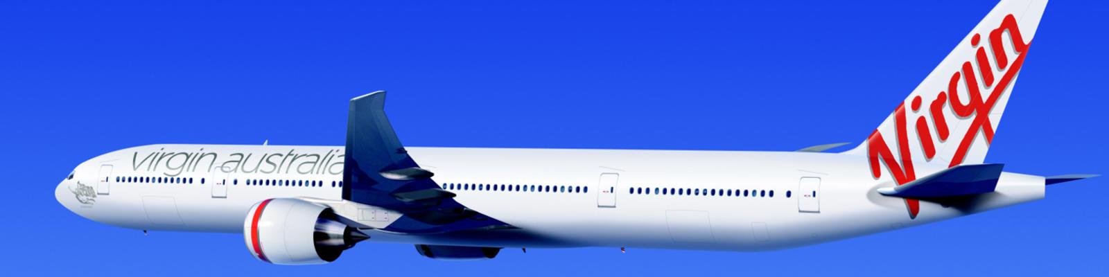 A Virgin Australia airplane flying through blue skies